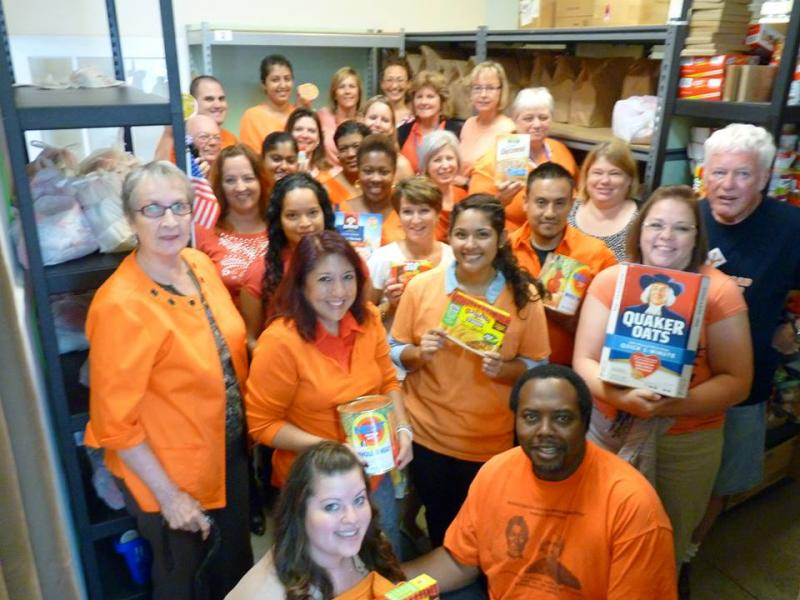 ACTS staff in the Food Pantry for Go Orange! for Hunger Action Day