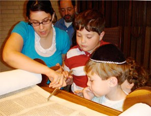 Education Fellow Lena Wise guides students as they examine the Torah.