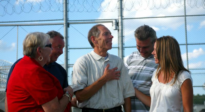 John Grega is surrounded by his family following his release from prison.