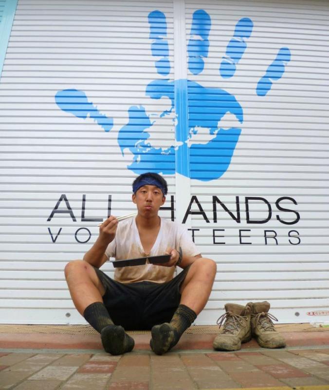 Volunteer Juin enjoys a bento box on Project Tohoku, Japan.