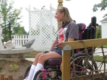Our friend, Karlie, laughs as she successfully completes the wheelchair maze!