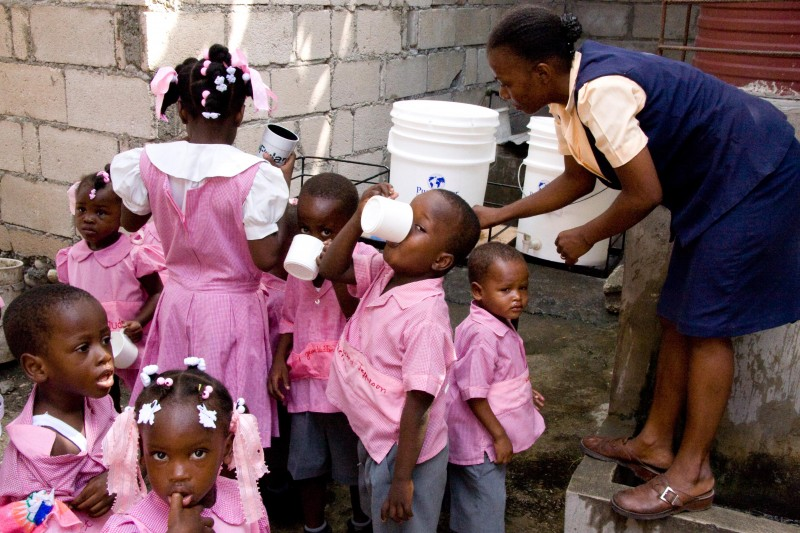 Kids drinking clean water in Cite Soleil