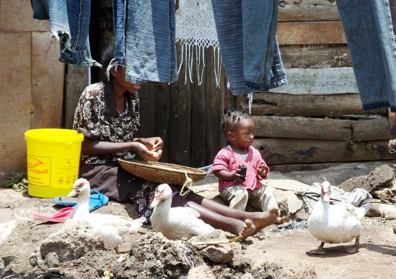 Mathare mother and child in their home