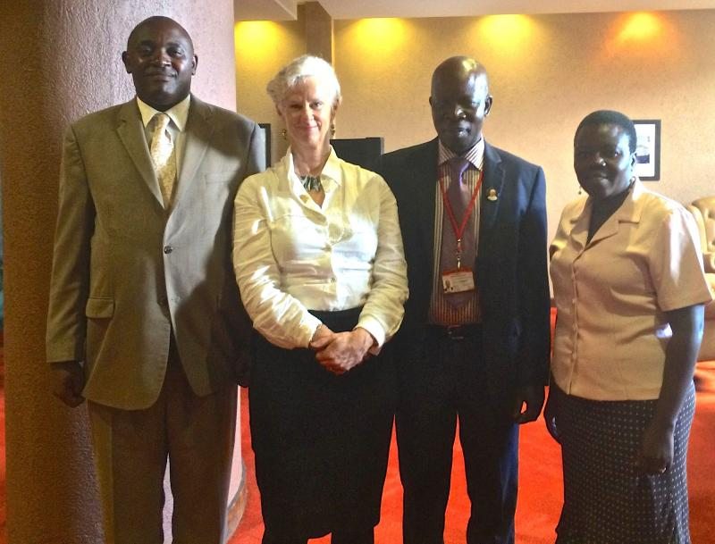 IAHPC Advocacy Officer Meeting with the Ministers of Health in Uganda: pictured with Katherine are (left) Honorary State Minister of Health, General Duties of Uganda, Dr. Chris Baryomunsi; Dr. Jacinto Amandua, Commissioner Ministry of Health, and Rose Kiw