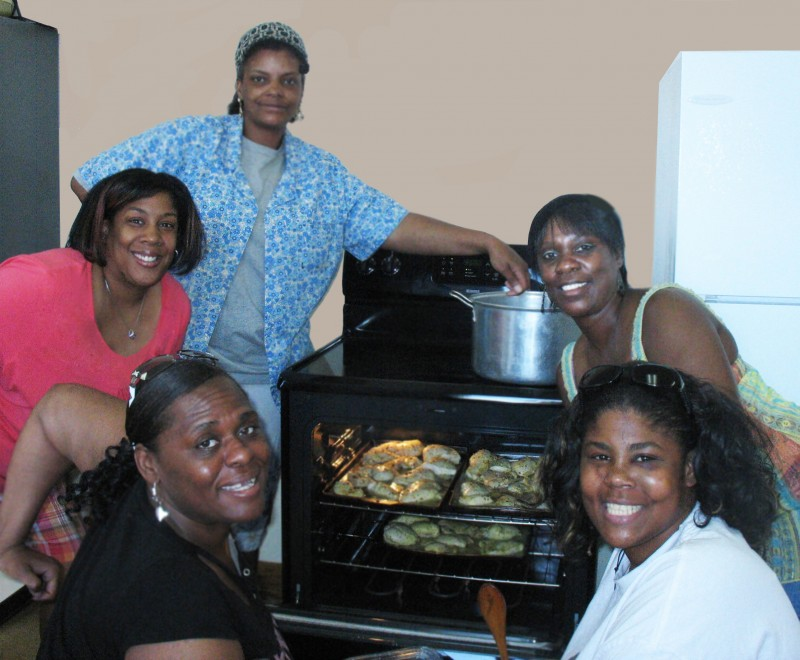 Women enjoy preparing a meal for the monthly awards luncheon.