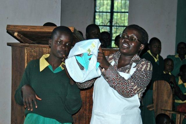 Girls learning to use reusable sanitary pads
