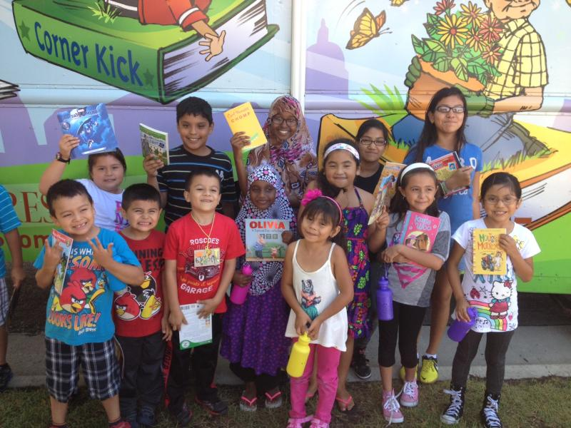 Ames Lake Summer Camp youth with the books they earned from the St. Paul Libraries Summer Reading Program.  Great job kids!