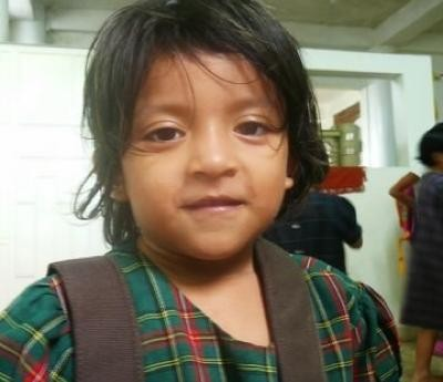 One of the over 100 orphans that received school supplies from USA New Horizons.