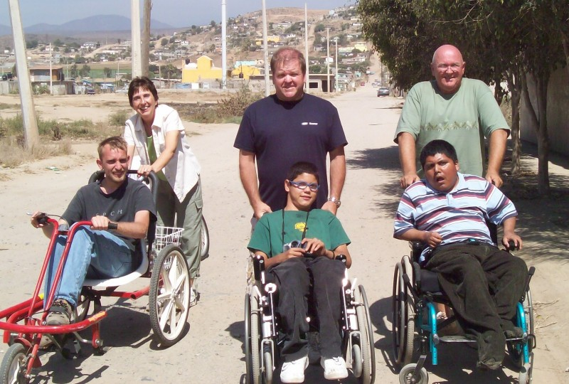 MexMed volunteers go for a stroll with two boys from Gabriel House (a home for handicapped children)