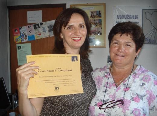 Woman graduating from a training program in the Europe and Central Asia region