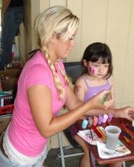 Teen Mentor painting her camp buddies face