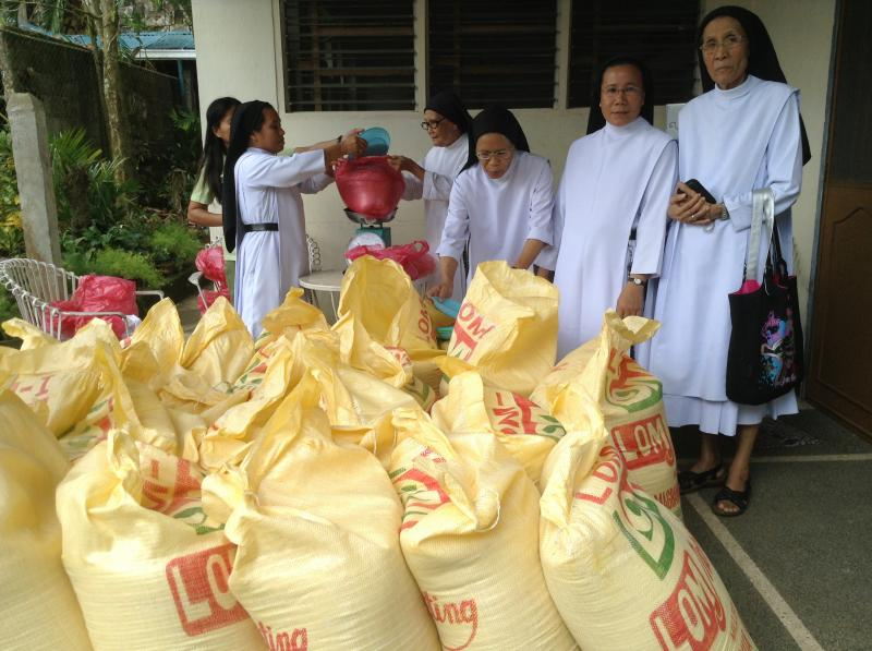 The sisters assisting in distribution of rice that was provided by MQAN.
