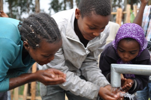 Clean water out of one of ICA's 15 water wells in Ethiopia